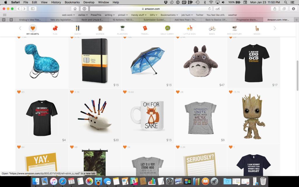 "A screenshot of Amazon.com's Interesting Finds section, featuring some bioluminescent plankton, a notebook, an umbrella, a Totoro, five funny teeshirts, a hedgehog-shaped pencil holder, a few notebooks, a coffee mug that says ""oh for [picture of a fox] sake"" and a Totoro wall scroll."