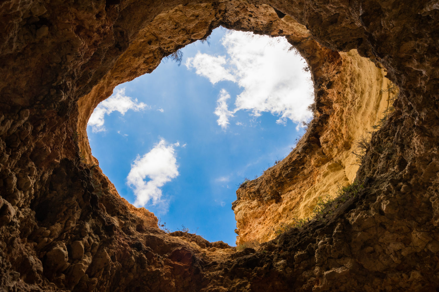 Standing in a hole looking up at the sky